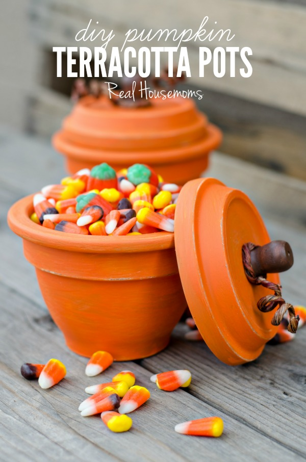 DIY Pumpkin Terracotta Pots Filled With Candy Corn