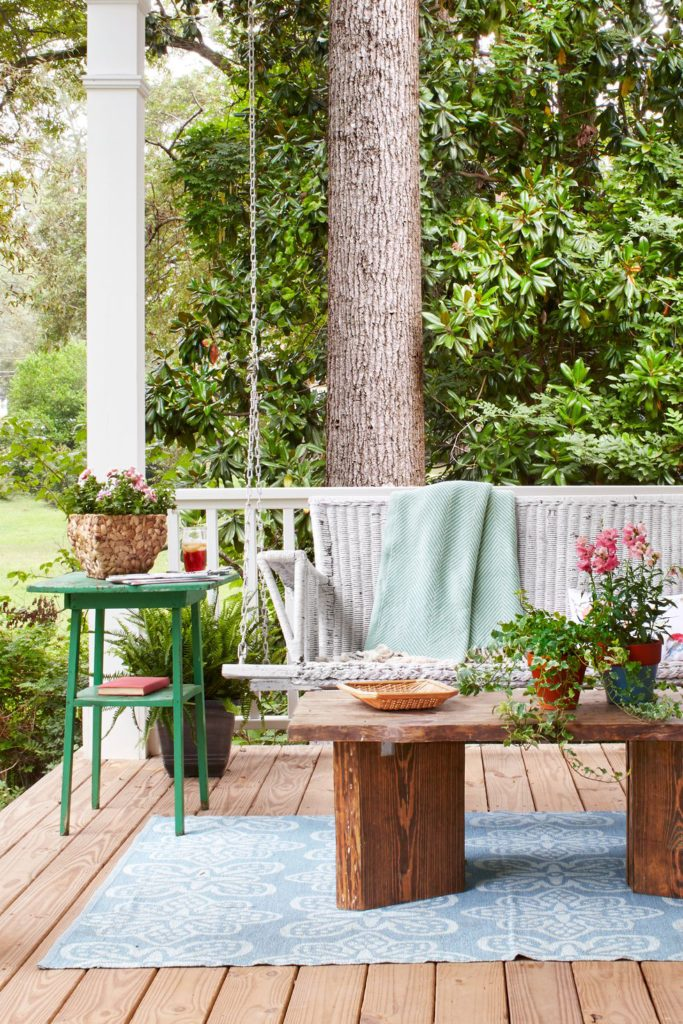 The charm that this swinging bench adds to this front porch is indescribable.