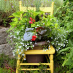 You won't believe how gorgeous this chair looks with just a few plants.