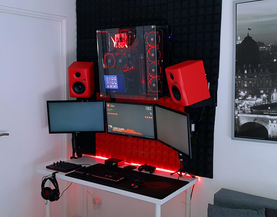 Red and White Gaming Room With Wall Mounted PC