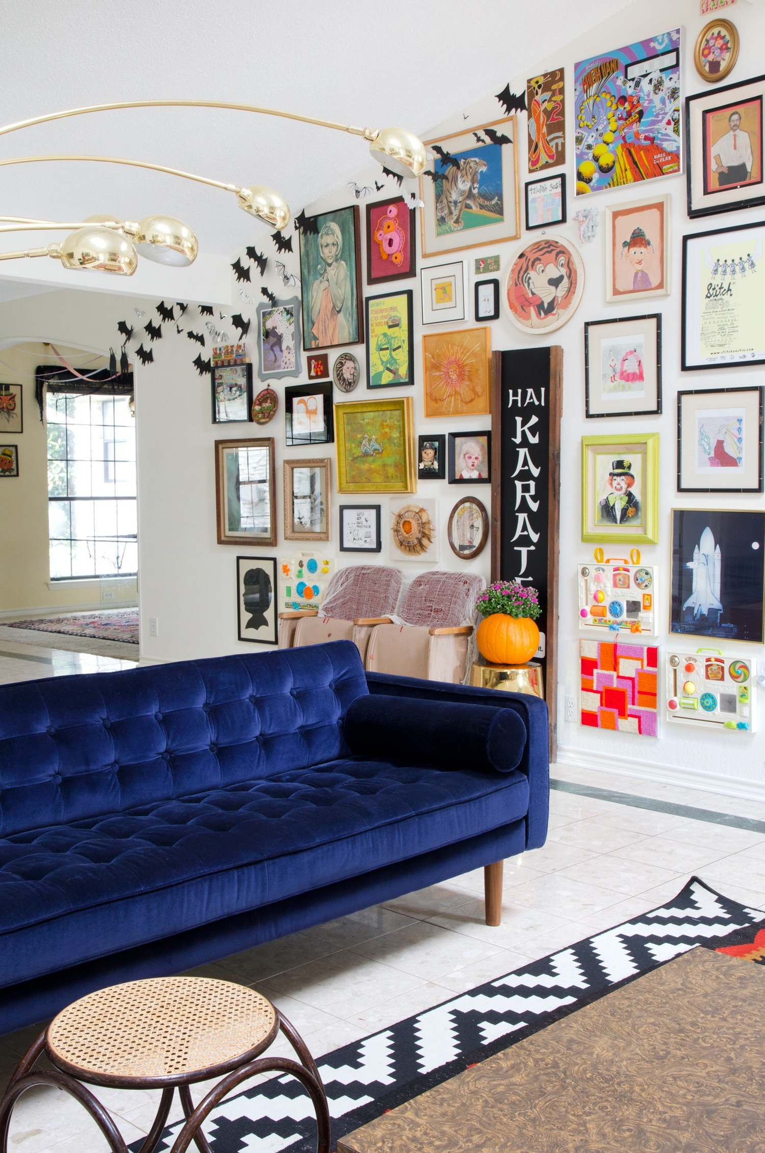 Blue Velvet Sofa With Gallery Wall