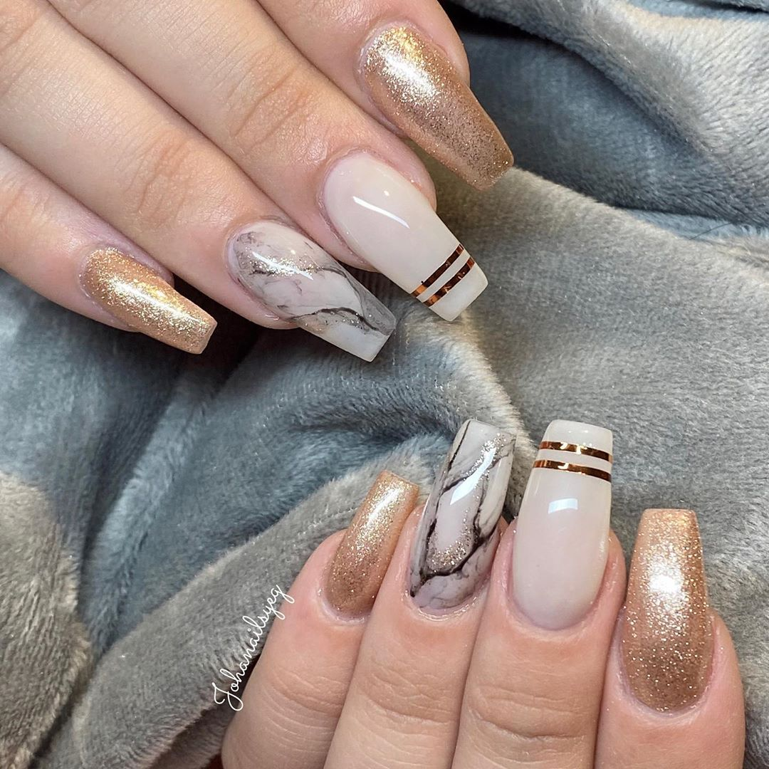White and Gold Marble Nails